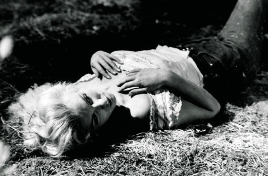 Marilyn Monroe lying alone on the ground in scene from film, River of No Return. (Photo by John Swope/The LIFE Images Collection/Getty Images)